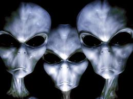 three-gray-aliens