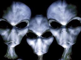 three-gray-aliens